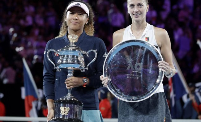 Japan\'s Naomi Osaka, left, holds her trophy after defeating Petra Kvitova, right, of the Czech Republic in the women\'s singles final at the Australian Open tennis championships in Melbourne, Australia, Saturday, Jan. 26, 2019. AP/PTI