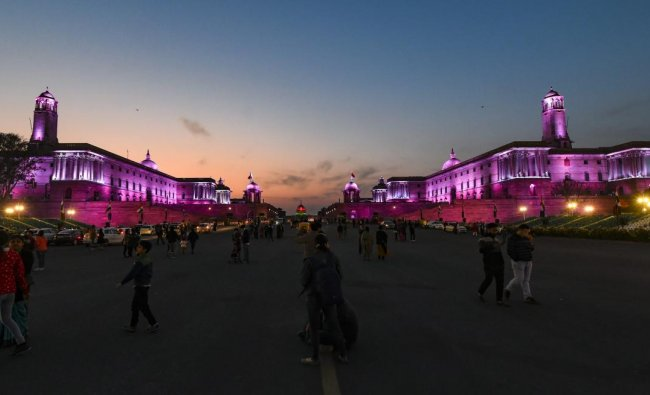 People gather near Raisina Hills illuminated with dynamic facade lighting on the occasion of Republic Day, in New Delhi, Saturday, Jan. 26,2019. (PTI Photo)