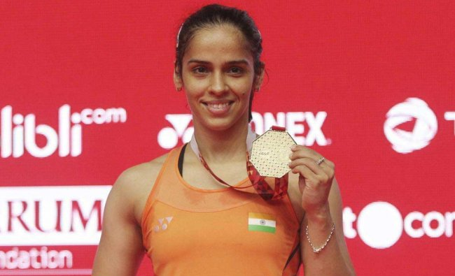 India\'s Saina Nehwal poses with the gold medal after winning against Spain\'s Carolina Marin during the final round of the women\'s single match of the Indonesia Masters badminton tournament at Istora Stadium in Jakarta, Indonesia, Sunday, Jan. 27, 2019. AP/PTI