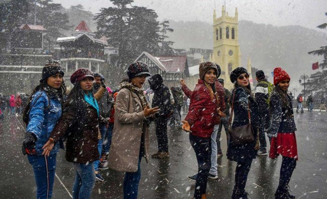 Tourists enjoy fresh snowfall, in Shimla, Sunday, Jan 27, 2019. (PTI Photo)
