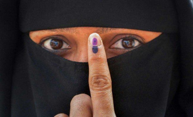 A woman shows her finger marked with indelible ink after casting her vote for the Malkapur Municipal Council election at Malkapur, in Karad, Sunday, Jan 27, 2019. (PTI Photo)