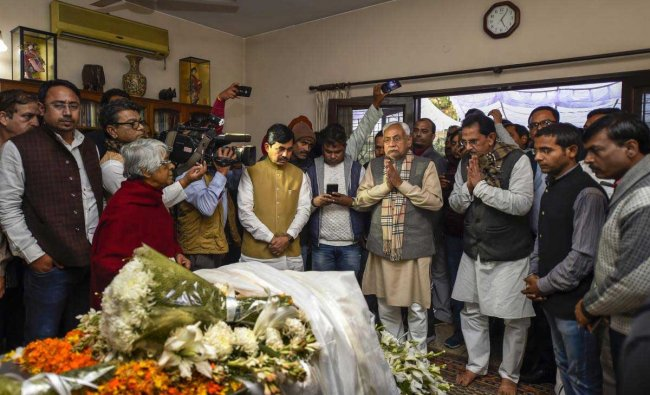 Bihar Chief Minister Nitish Kumar pays his last respects to the former defence minister and veteran socialist George Fernandes, at his residence in New Delhi, Tuesday, Jan 29, 2019. Fernandes, who was the defence minister in the NDA government headed by the late Atal Bihari Vajpayee, passed away today, following a prolonged illness. Fernandes was 88. (PTI Photo)