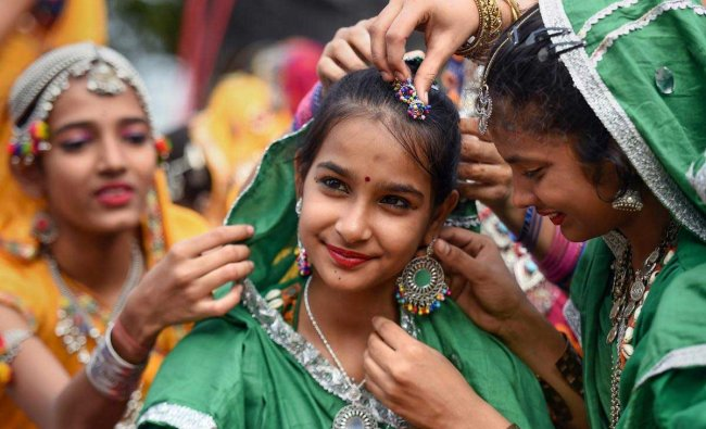 Students dressed in colourful attire participate in the 10th Hindu Spiritual and Service Fair 2019, in Chennai, Tuesday, Jan 29, 2019. (PTI Photo)