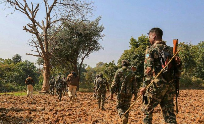A team of CRPF\'s 209 Commando Battalion for Resolute Action (CoBRA) battalion during a search operation after an encounter with Naxalites along the border of Khunti and West Singhbhum districts, Tuesday, Jan. 29, 2019. At least five Naxals have been killed in an encounter with security forces near the Rotkatoli village under Bari police station at 6:20 AM. (PTI Photo)