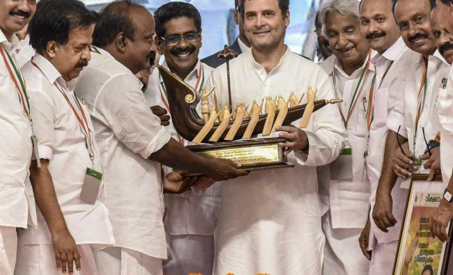 Congress President Rahul Gandhi being presented a memento at the party\'s state level convention near Marine Drive in Kochi, Tuesday, Jan 29, 2019. (PTI Photo)