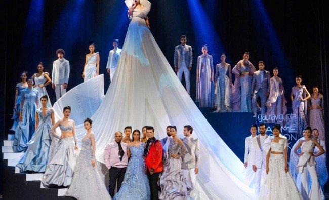 Bollywood actress Tabu and film director-producer Karan Johar along with the models showcase the creation by designer Gaurav Gupta during the opening of Lakmé Fashion Week (LFW) Summer Resort 2019 in Mumbai, Tuesday, January 29, 2019. (PTI Photo)