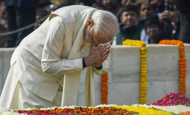 Prime Minister Narendra Modi pays homage to Mahatma Gandhi on his 71st death anniversary, also observed as Martyrs\' Day, at Rajghat in New Delhi, Wednesday, Jan. 30, 2019. (PTI Photo)
