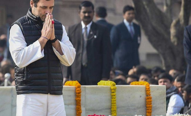 Congress President Rahul Gandhi pays homage to Mahatma Gandhi on his 71st death anniversary, also observed as Martyrs\' Day, at Rajghat in New Delhi, Wednesday, Jan. 30, 2019. (PTI Photo)