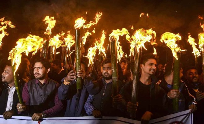Activists of All Assam Students Union (AASU) and other organizations take part in a torch light rally procession to protest against the Citizenship (Amendment) Bill 2016, in Guwahati, Thursday, January 31, 2019. (PTI Photo)