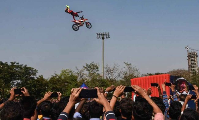A stuntsman performs as people click his pictures at an event at Nerul in Navi Mumbai, Thursday, Jan 31, 2019. (PTI Photo)