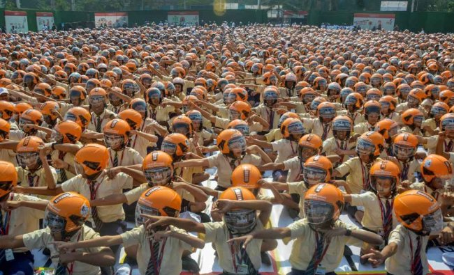 School students wear helmets during a Guinness Record attempt to spread awareness on road safety measures, organised by ICICI Lombard through its CSR initiative 'Ride To Safety', in Mumbai, Thursday, Jan 31, 2019. (PTI Photo)