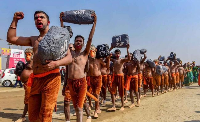Hindu devotees, dressed up as Ram Sena, take part in a religious procession to press for the construction of the Ram Temple in Ayodhya, during the Kumbh Mela in Prayagraj (Allahabad), Friday, Feb 1, 2019. (PTI Photo)
