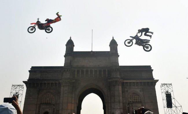 Motorcross athletes perform bike stunts at Gateway of India during the Red Bull FMX JAM event in Mumbai, Saturday, Feb. 2, 2019. (PTI Photo/Mitesh Bhuvad)