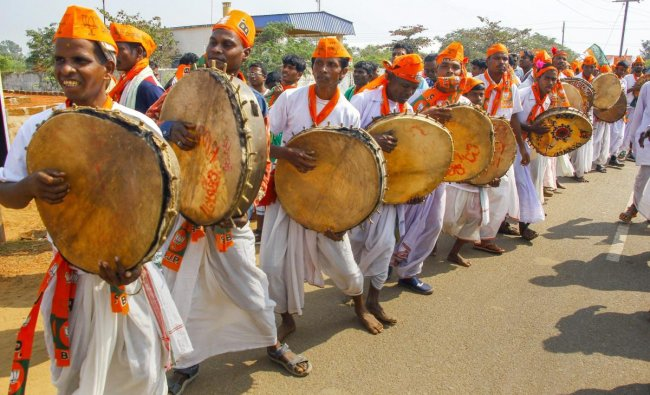 Puri: BJP Tribals supporters perform folk dance during the national tribal convention (Adhivasi Adhikar rally) by BJP Janajati(ST) Morcha(tribal wing), in Puri, Sunday, Feb. 03, 2019. (PTI Photo)