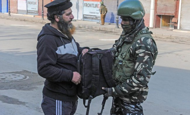Security personnel checks the bag of a pedestrian during Prime Minister Narendra Modi\'s event at Sher-e-Kashmir International Conference Centre (SKICC), in Srinagar, Sunday, Feb. 03, 2019. According to the officials, the Special Protection Group (SPG) have been deployed at SKICC where PM Modi will inaugurate two projects. ( PTI Photo)