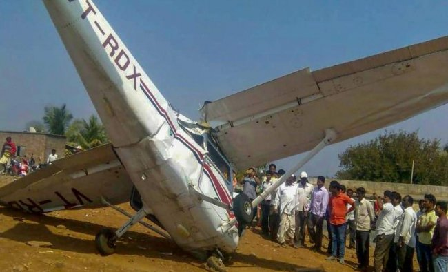 Pune: People look at the wreckage of a crashed aircraft, which was being used for civil aviation training, in Pune district, Tuesday, Feb. 5, 2019. (PTI Photo)