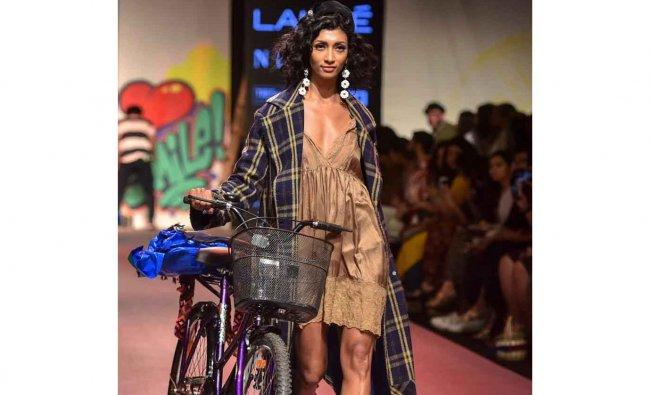 A model walks the ramp showcasing the collection of designer Aneesh Arora during the Lakmé Fashion Week Summer Resort 2019, in Mumbai on Jan. 31, 2019. Credit: (PTI Photo)