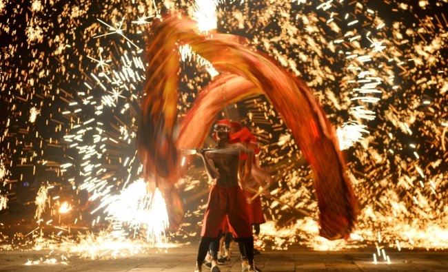 Performers take part in a fire dragon dance under a shower of molten iron sparks on the first day of the Chinese Lunar New Year of the Pig, in Zaozhuang, Shandong province, China February 5, 2019. Picture taken February 5, 2019. REUTERS/Stringer