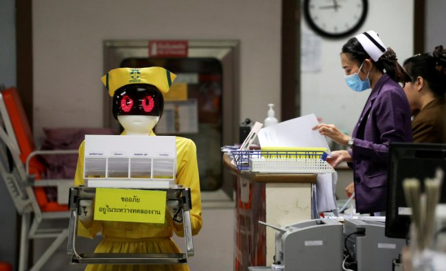 A robot wearing a nurse costume carries medical documents at Mongkutwattana General Hospital in Bangkok, Thailand, February 6, 2019. REUTERS/Athit Perawongmetha