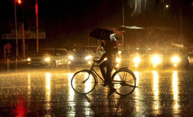 A silhouette of a cyclist seen during heavy rainfall, in Patiala, Thursday, Feb 7, 2019. (PTI Photo)