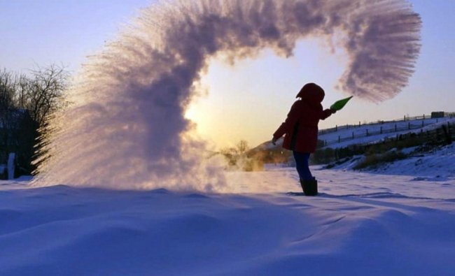 a woman throws boiling water into the freezing air as its instantly condenses into an elaborate pattern of ice crystals in Irkutsk, Russia . Residents of Russia\'s Urals and Siberia where temperatures recently plunged to minus 40 degrees Fahrenheit have taken to social media to celebrate the cold. Temperatures in Siberia and the Urals earlier this week plunged to around minus 40 degrees Centigrade (minus 40 degrees Fahrenheit) which is unusually low even for the cold-resistant Russians. AP/PTI