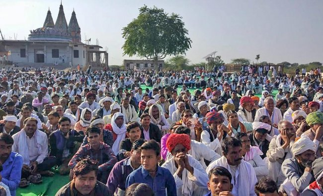 Members of the Gujjar community hold a dharna demanding reservation, in Sawai Madhopur, Friday, Feb 8, 2019. Gujjar leader Kirori Singh Bainsla today, started a dharna along with his supporters on the railway tracks in Rajasthan\'s Swai Madhopur district, demanding reservation for five communities including Gujjars. (PTI Photo)