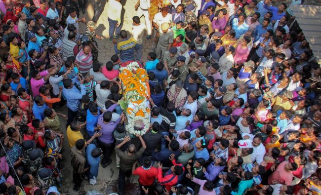 People attend the funeral of Trinamool Congress MLA Satyajit Biswas, in Nadia district of West Bengal, Sunday, Feb. 10, 2019. Satyajit was shot dead Saturday when he was attending a programme to inaugurate a Saraswati puja. (PTI Photo)