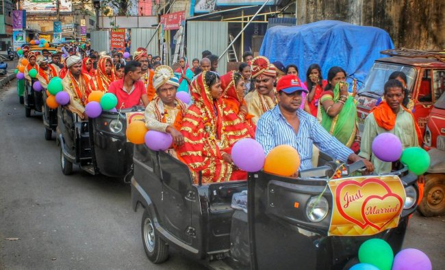 55 newly wedded couples ride autorickshaws in a procession after a mass marriage ceremony, in Angul, Odisha, Sunday, Feb 10, 2019. (PTI Photo)