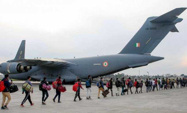 Stranded Kashmir bound passengers queue up to board a C-17 aircraft of the Indian Air Force for the valley, in Jammu, Monday, Feb 11, 2019. (PTI Photo)
