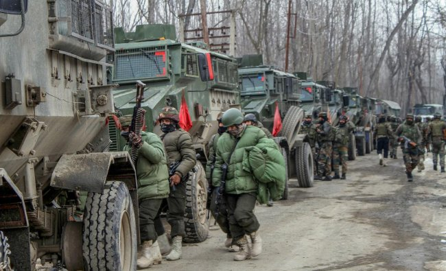 Army soldiers near the house where militants were hiding during an encounter in Ratnipora area of Pulwama district of south Kashmir, Tuesday, Feb 12, 2019. One army soldier and one militant were killed in the encounter. (PTI Photo)