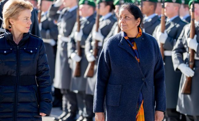 Ursula von der German Defence Minister Ursula von der Leyen (R) greets her Indian counterpart Nirmala Sitharaman with military honours at the Defence ministry in Berlin, on February 12, 2018. (Photo by Christoph Soeder / dpa / AFP)