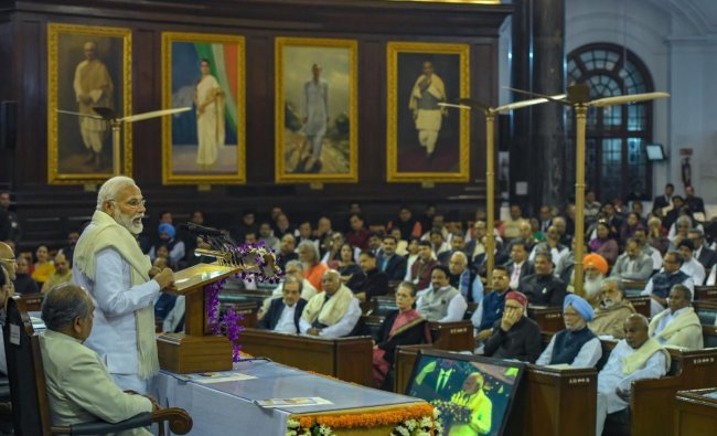 Prime Minister Narendra Modi addresses an event to unveil a life-size portrait of former prime minister Atal Bihari Vajpayee at the Central Hall of Parliament House, in New Delhi, Tuesday, Feb 12, 2019. (PTI Photo/Vijay Verma)