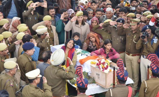 Bereaved family members of CRPF martyr Pradeep Kumar, who lost his life in Thursday\'s Pulwama terror attack, pay last respects in Kannauj on Saturday9. (PTI Photo)