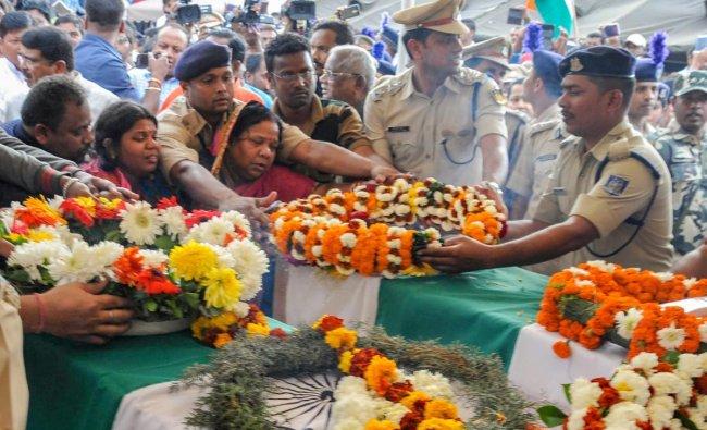 Family members of slain CRPF Jawan Manoj kumar Behera pay their last respects as his mortal remains arrive at Biju Patnaik International Airport, in Bhubaneswar, Saturday, Feb. 16, 2019. Behera lost his life in the Pulwama terror attack. (PTI Photo)