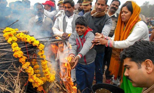 Kin of slain CRPF jawan Ram Vakeel perform last rites during his cremation, in Mainpuri, Saturday, Feb. 16, 2019. Vakeel lost his life in Thursday\'s Pulwama terror attack (PTI Photo)