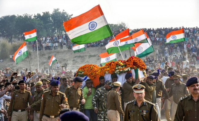 A large number of people attend the funeral procession of CRPF jawan Ramesh Yadav, who lost his life in Thursday\'s Pulwama terror attack, at Masaurhi, in Varanasi, Saturday, Feb. 16, 2019. (PTI Photo)