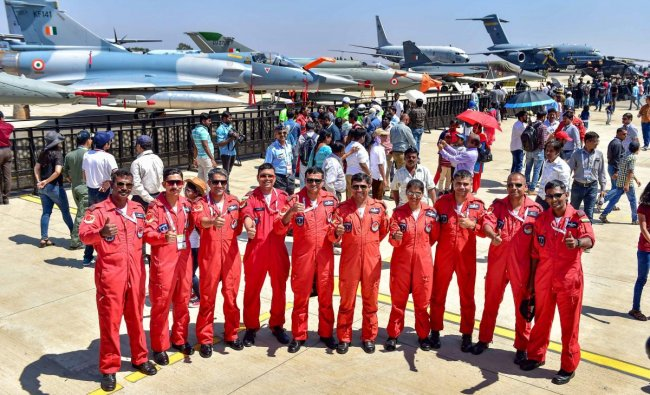 IAF\'s Sarang display team pilots pose for photograph during a rehearsal for the 12th edition of AERO India 2019 at Yelahanka airbase in Bengaluru, Monday, Feb 18, 2019. (PTI Photo)