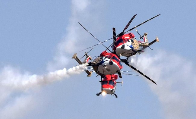 Sarang Helicopters performing at the inaugural day of Aero India organised by Defence Ministry at Yalahanka Aero Space in Bengaluru on Wednesday. (DH Photo by S K Dinesh)