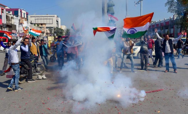 People jubilate with a Tricolour as they wait for the arrival of IAF pilot Wing Commander Abhinandan Varthama, in Prayagraj (Allahabad), Friday, March 01, 2019. Varthaman, who was captured by Pakistan after his jet went down following a strike by an enemy missile, is expected to be released today. PTI