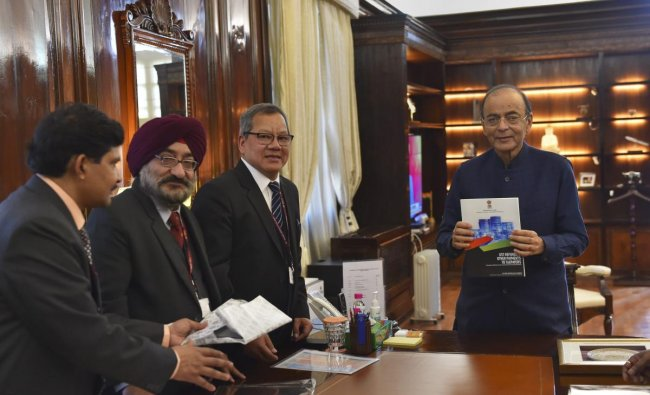 Finance Minister Arun Jaitley with Controller General of Accounts (CGA) Anthony Lianzuala (2nd R) releases a compendium at North Block in New Delhi. PTI