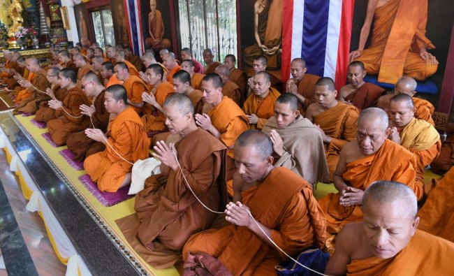 Buddhist monks from Thailand offer special prayers for world peace at Watpa Temple in Bodhgaya. PTI