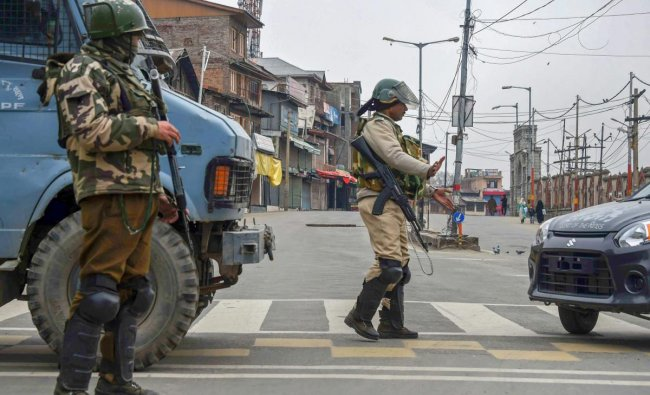 A security personnel stops a vehicle during restrictions in Downtown Srinagar, Friday, March 1, 2019. Authorities have imposed restrictions in parts of the city as a precautionary measure in view of apprehensions of law and order after the Centre banned Jamaat-e-Islami Jammu and Kashmir for five years. PTI