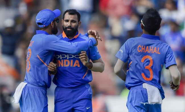 Indian cricket player Mohammed Shami celebrates with teammates the dismissal of Australia\'s Glenn Maxwell on the first One Day International (ODI) series cricket match, at Rajiv Gandhi International Cricket Stadium in Hyderabad.