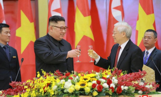 North Korean leader Kim Jong Un, center left, and Vietnamese President Nguyen Phu Trong toast during dinner in Hanoi, Vietnam. The content of this image is as provided and cannot be independently verified. AP/PTI
