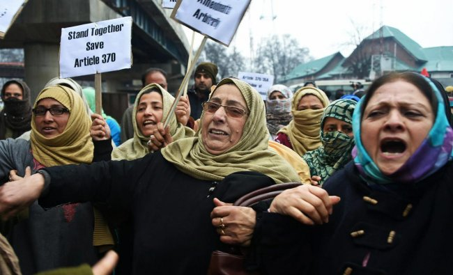 National Conference (NC) workers raise slogans during a protest against arbitrary use of \'legislative authority\' by the Jammu and Kashmir Governor, in Srinagar. PTI