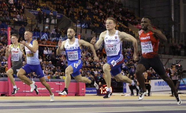 Gold medalist Jan Volko of Slovakia, 2nd right, and bronze medalist Emre Zafer of Turkey, right, race to the finish line in the men\'s 60 meters race final at the European Athletics Indoor Championships at the Emirates Arena in Glasgow, Scotland. AP/PTI