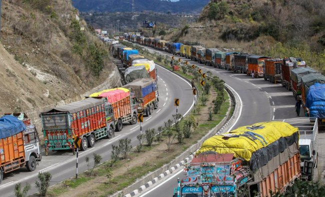 A queue of stranded trucks on Jammu-Srinagar highway, which is closed due to heavy rain and landslides, at Nagrota on the outskirts of Jammu. PTI Photo