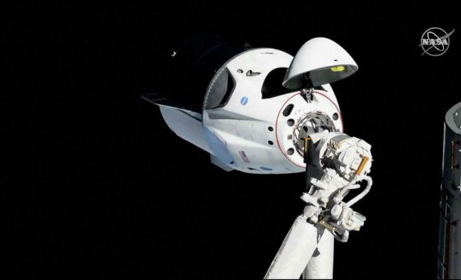 In this photo provided by NASA, the SpaceX Crew Dragon is pictured about 20 meters (66 feet) away from the International Space Station's Harmony module, Sunday, March 3, 2019. SpaceX\'s new crew capsule arrived at the International Space Station on Sunday, acing its second milestone in just over a day. AP/PTI