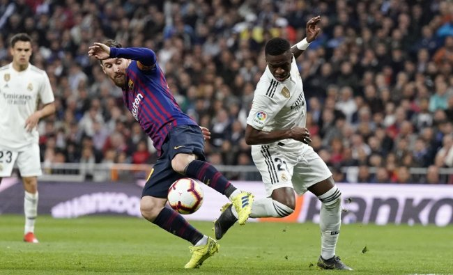 Barcelona forward Lionel Messi, left, and Real forward Vinicius Junior fight for the ball during the Spanish La Liga soccer match between Real Madrid and FC Barcelona at the Bernabeu stadium in Madrid. AP/PTI