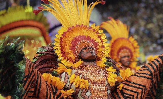A dancer from the Mocidade Alegre samba school performs during a carnival parade in Sao Paulo, Brazil. AP/PTI